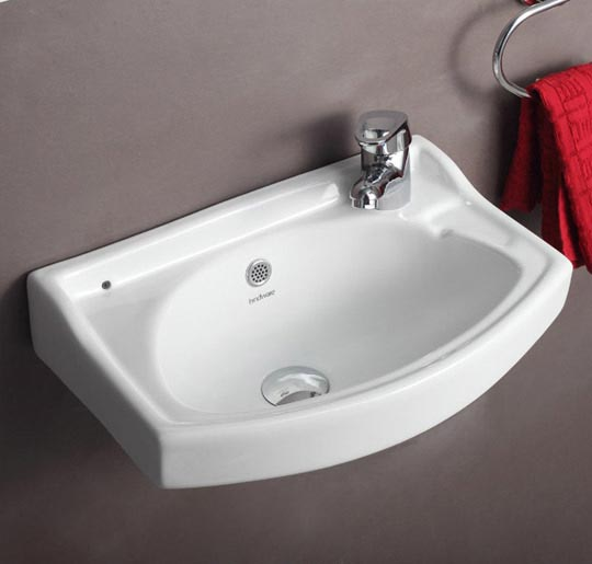 Compact design for small bathrooms. Side semi-punched tap hole.<br />Available in Starwhite &amp; Ivory color